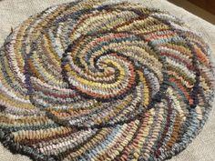 Spiral Chair Pad -- hit & miss rug-hooking      from turorial by Karen of primitivespirit  primitivespirit.wordpress.com/2012/03/09/hook-a-spiral-ch...