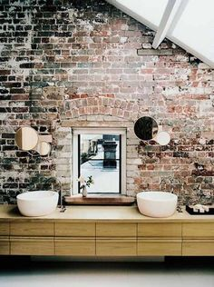 I just love exposed brick and stone walls. The rustic texture plays so well against soft velvet and silk textiles. Throw in a salvaged wood floor and I'm in heaven.