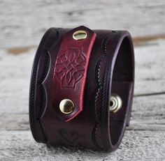 Celtic Wolf Leather Cuff. $60.00, via Etsy.