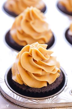 Chocolate Peanut Butter Cupcakes Recipe -- made with a mini Reese's peanut butter cup in the middle of the cupcake! | gimmesomeoven.com #dessert