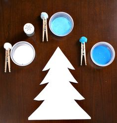 Christmas Tree Craft for Kids.  I like the idea of using clothes pins to hold the cotton balls so little hands don't get as messy.