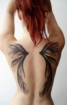 usually i HATE wing tattoos, but this one is really beautiful! its like the wings of a fairy or some kind of insect. its not the typical angel wings every basic bitch has. so i am really feelin this version of wings!!