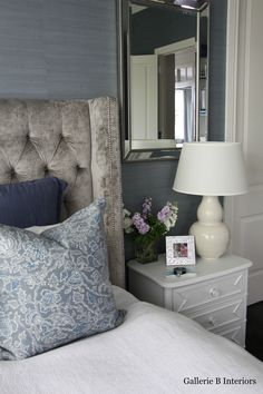 My Master Bedroom with grey velvet studded bedhead and blue grasscloth wallpaper.