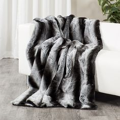 7f6ee2fbe9 A dyed chinchilla print Rex rabbit fur throw blanket is a simple way to add  a