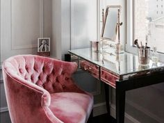 Pink velvet chair and mirrored desk for a glamorous, French-inspired workspace or vanity