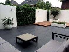 moderner garten 8 Deck Design Ideas That Will Completely Transform an Outdoor Space peter hoek black tile small modern garden with stucco walls The post 8 Deck Design Ideas That Will Completely Transform an Outdoor Space appeared first on Garden Ideas. Modern Garden Design, Contemporary Garden, Patio Design, Landscape Design, Modern Design, Terrace Garden, Garden Spaces, Modern Backyard, Backyard Landscaping