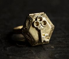 Items similar to Locket Ring - Poison Gold Brass Skeleton Key Hexagon Secret Compartment on Etsy Custom Promise Rings, Promise Rings For Couples, Rings For Men, Ring Ring, Gothic Jewelry, Unique Jewelry, Poison Ring, Secret Compartment, Custom Gift Boxes