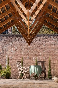 Timber truss with steel cable tension chords Timber pavilion by deBOSSA
