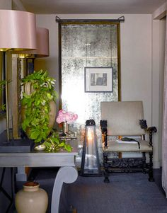 A Glowing Entrance:   Designer Susan Ferrier used a Richard Mulligan lantern, a 17th-century armchair, Directoire Dog Bed console, with custom finish, by Bobby McAlpine for MacRae, and Pier mirror fabricated by Stonehenge Framing.
