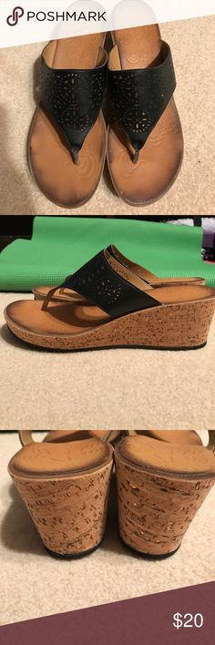 Clarks Black Leather Wedge Sandal Excellent preowned condition. Leather upper. Cork heel and rubber sole. Distressed cushion insole. Cork heel has flecks of gold embedded. Very comfortable and cute sandal. Clarks Shoes Sandals