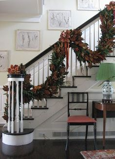Dried magnolia leaves draped on staircase