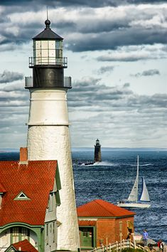 Portland Head Light and the Ram Island Ledge Light. The Portland Light is a historic lighthouse in Cape Elizabeth, Maine. Ram Island Ledge Light is a lighthouse in Casco Bay, Booth Harbor, Maine. Cape Elizabeth Maine, Grands Lacs, Maine Lighthouses, Lighthouse Pictures, Beacon Of Light, Beacon Of Hope, New England, Places To Go, Beautiful Places