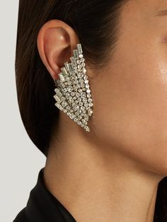 Only the most glamorous accessories could match the 1980s feel of Saint Laurent's AW16 collection. A striking piece from the runway, these silver-tone brass Cocktail Wing earrings are encrusted with a sparkling array of clear faceted crystals – they're the perfect way of bringing a vintage feel to elegant eveningwear. Secure them with the clip-on fastening, tucking your hair neatly behind your ears.