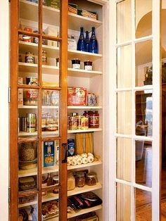 Use recycled vintage doors to create a kitchen pantry. On an existing closet or built-in shelf, add glass-paned doors for an instant storage solution.