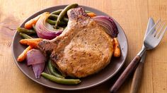 Enjoy dinner tonight with these pork chops and vegetables baked using Green Giant Select® Frozen Whole Green Beans.