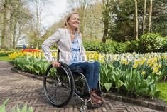 Disability Stock Image An afternoon at Keukenhof, Netherlands - PUSHLiving Photos Spinal Cord Injury, Young Women, Netherlands, Stock Photos, Outfits, Image, Woman, Watch, Videos