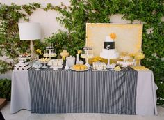 I like the idea of a backdrop behind cake. Totally not necessary. Ha. Don't know if cake will be in ballroom or by window in bay room???