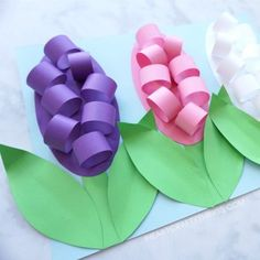 Learn how to make these beautiful paper Hyacinth flowers for a fun spring craft. The petals and leaves pop off the page giving the craft an awesome 3D effect. Find more fun spring flower crafts on our website too like tulip crafts, hyacinth crafts and cupcake liner flowers.