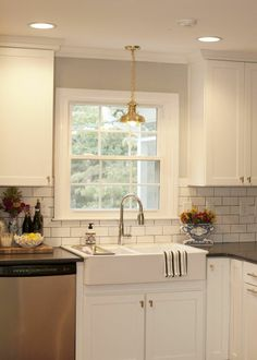 Jessies Epley Shoer's Raleigh home: what light grey paint (revere pewter?) and a brass fixture might look like