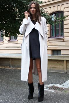 White coat over black dress, black ankle, mid-calf boots #minimalist #style #fashion