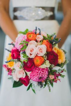 Photo via Project Wedding Katelyn carried a vibrant, late summer/early fall bouquet of ranunculus, dahlias, roses, and lavender. Photo by Taylor Lord Photography Florals by Floral Design of Europe Event Coordination by JA Special Events Bouquet Bleu, Bridal Bouquet Pink, Coral Wedding Bouquets, Ranunculus Bouquet, Bridesmaid Bouquets, Bouquet Wedding, Wedding Bridesmaids, Spring Wedding Colors, Fall Wedding