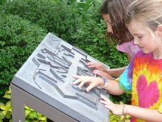 accessible gardening | Guests explore a tactile map of the Buehler Enabling Garden
