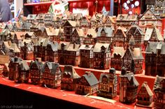Little houses on a market stall.
