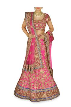 This lehenga choli is featuring in silk fabric with zari embroidery all over, accentuated with dabka work. Matching pink blouse and embroidered pink dupatta.