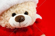 smiling christmas teddy bear. - Close-up of a smiling Christmas teddy.