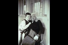 """An Artist is Born -Jean Paul Gaultier with his grandmother circa 1958. Born on April 24, 1952 in Arcueil, France, Gaultier never received formal training to become a designer. But by 1976, he'd launched his own line, and his frivolous and fantastical designs earned him the nickname """"enfant terrible"""" in the fashion industry. He went on to dress dress a host of iconic women on and off the runway from Madonna to the burlesque queen Dita von Teese. The designer is now an industry onto himself…"""