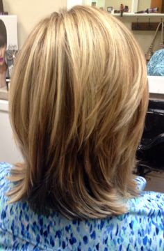 Highlights & lowlights Cut / medium- length layers Stylist: Brooke Dimock (Image Makers Salon)