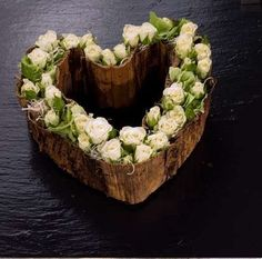 White roses heart - white roses ' Vivian, hydrangea, tillandsia and moss on floral foam and finished with a kind of banana leaf