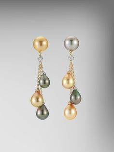 From the Bespoke collection, Peacock and Golden Pearl Earrings with Diamonds set in 18kt Yellow Gold.