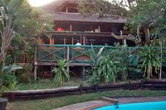 Interesting places to stay in South Africa - Sodwana Bay Lodge - Sodwana Bay is one of the world's top dive sites. The world's southern-most coral reefs harbour over 1200 species of Coral Fish, Rays, Eels and Turtles while Whale sharks, Dolphins, Sharks and Whales are common visitors. The Raggie Sharks and Turtles are popular guests in the summer.... #whalewatching #southafrica #photosafari #tourism #extremefrontiers #sodwanabay #adventure #holiday #vacation #safari #tourist #travel Bay Lodge, Front Door Porch, Whale Sharks, Whales, Whale Watching, Dolphins, Diving, South Africa, Tourism