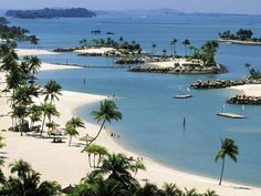 Sentosa, Singapore. A wonderful place to visit for old and young with beautiful beaches. Fun from daylight into the night.