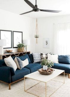 modern boho living room decor with blue velvet sofa and gold coffee table, navy sofa and boho pillows in living room design decoration Step Inside an Austin Home That Pairs Cozy Neutrals With Loads of Art Boho Living Room, Living Room Modern, Interior Design Living Room, Cozy Living, Blue Couch Living Room, Living Room Tables, Small Living Room Sectional, Living Room Artwork, Living Room Lamps