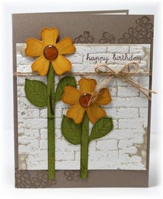 handmade card from Scrappin' and Stampin' in GJ ... die cut flowers ... luv the inked embossing folder technique on the aged brick wall panel ...