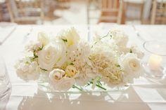 White floral centerpieces.  Photo by The Nichols.  #white #tablescape