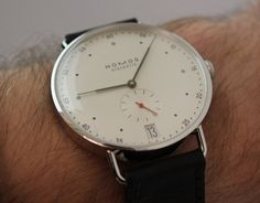 Hands-on review & original photos of the Nomos Metro Neomatik  watch with price, background, specs, & expert analysis.