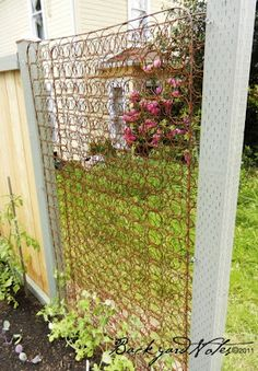 Inside of an old mattress repurposed into a plant trellis. the rented spade: wall