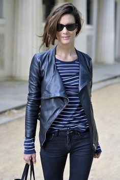 cool. jacket, striped shirt, black jeans, sunglasses, and asymmetrical haircut.