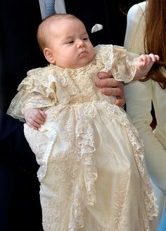 Prince George of Cambridge, the three-month-old prince, wearing a long christening robe arrive at the Chapel Royal in St James's Palace ahead of the christening by the Archbishop of Canterbury on 23.10.13 in London, England.