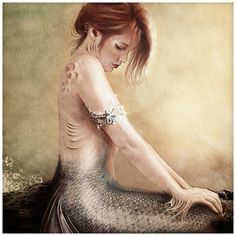 I love the peaceful look on the mermaids face- The water color feel to this piece matches well with the subject matter-
