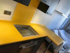 Stylish yellow worktop with a matching Corian sink Corian Sink, Corian Worktops, Work Tops, Solid Surface, Teamwork, Corner Desk, Kitchen Design, Stool
