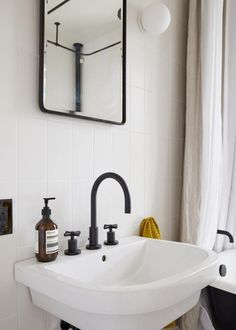"The modern pedestal sink is the Piazza from Lacava: ""It looks very happy and has good deck space compared to others,"" notes Thomas. The faucet is the East Linear in flat black from Newport Brass."