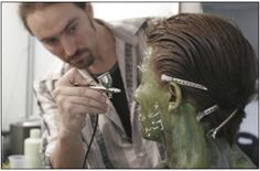 David Monzingo touches up a makeup for a character called The Cactus Kid created by Stan Winston Studio for a soft drink called Oasis.