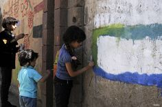 SANA'A, YEMEN- Children draw paintings on the wall of University of Sana'a reacting to the ongoing war in the country
