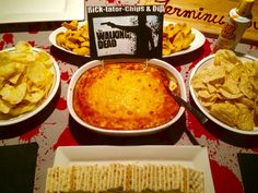Rick-tator-Chips & Dip for appetizers at your Walking Dead dinner party! The baked dip is a Cheddar Cheese and Bacon Dip. And don't forget Michonne's Cheese Whiz!!!
