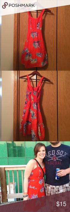 America Eagle Sundress ^^American Eagle Floral sundress. Crisscross back and stretchy in back of chest. Pre-loved, good condition. It's too small now so it does not fit my mannequin. There is an old photo of me in it to show look. Cotton and lined. Orange red color.^^ American Eagle Outfitters Dresses