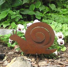 Rusty Finish Metal Garden Art Snail Yard Stake. $12.99, via Etsy.